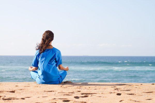 meditating-on-the-beach-e1583234613692